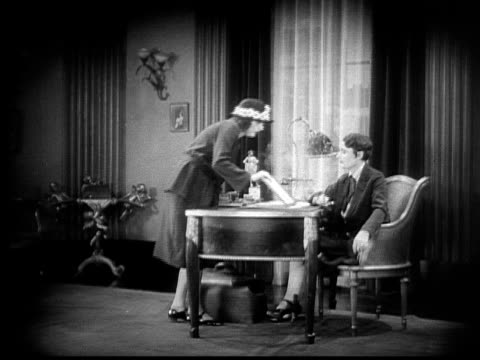 ms, cu, b&w, female musician coming on interview, 1920's  - ermafrodita video stock e b–roll