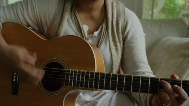 female musician - strumento musicale video stock e b–roll