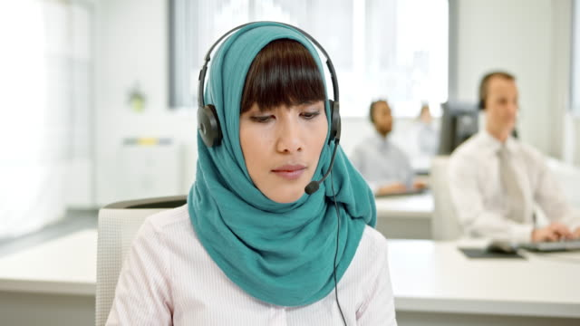 ld female muslim call center operator during a video call - islam stock videos & royalty-free footage