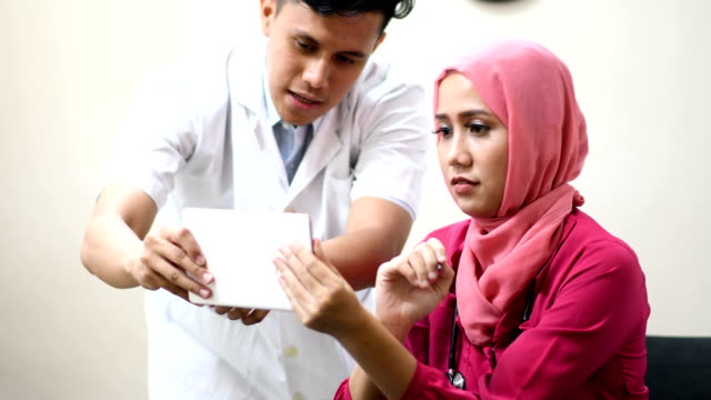 female muslim doctor consulting with an undergraduate - indonesian ethnicity stock videos & royalty-free footage