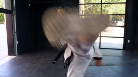 ts female muslim self defense instructor practicing kick in gym - encouragement stock videos & royalty-free footage