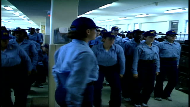 stockvideo's en b-roll-footage met female naval recruits standing in attention from sitting in barracks - militaire training