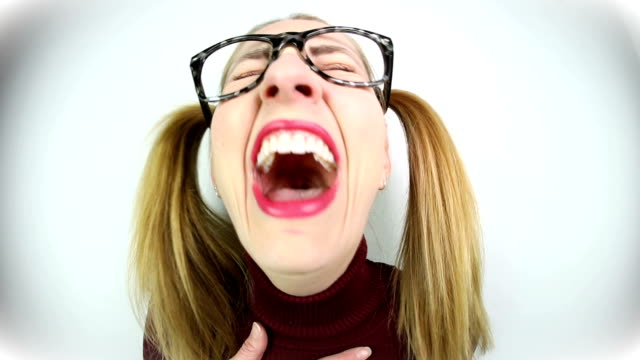 female nerd laughing hysterically - wide angle stock videos & royalty-free footage