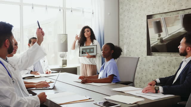 female neurologist consults with colleagues about a patient's brain scan - asking stock videos & royalty-free footage
