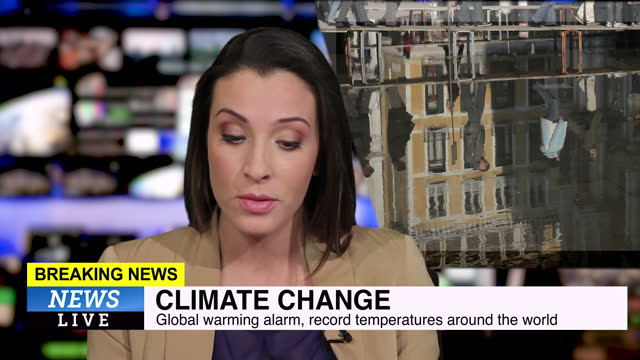 female news presenter reading the evening news about climate change - journalist stock-videos und b-roll-filmmaterial