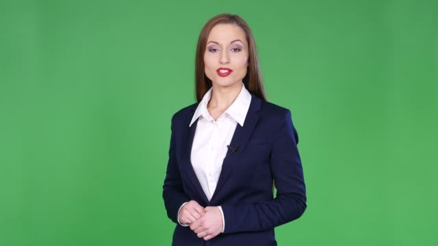 4k female newscaster on green background - commentator stock videos & royalty-free footage