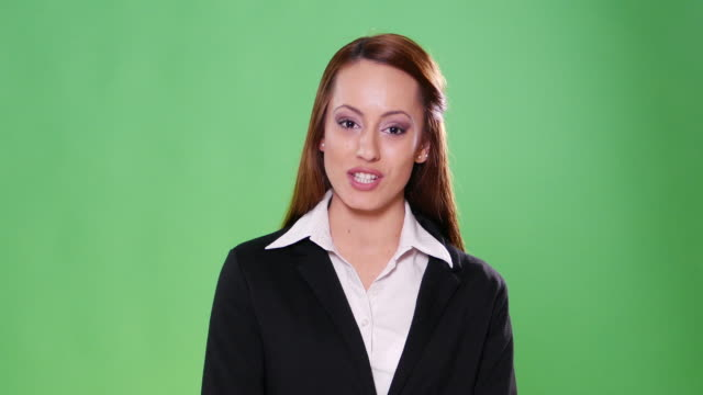 4k female newsreader with back suit on green background - presenter stock videos & royalty-free footage
