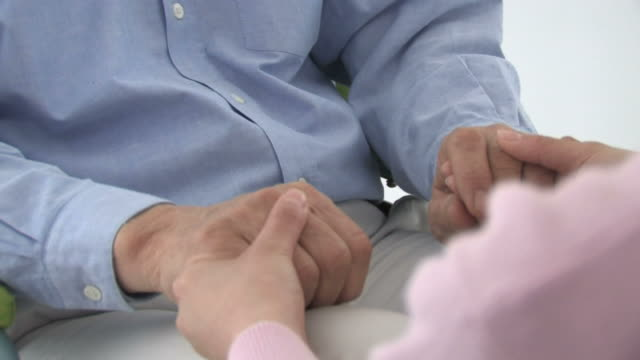 zo female nurse holding hands of patient - social services stock videos & royalty-free footage