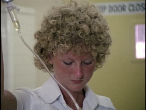 1978, cu zi female nurse preparing iv drip, los angeles, california, usa - female nurse stock videos & royalty-free footage