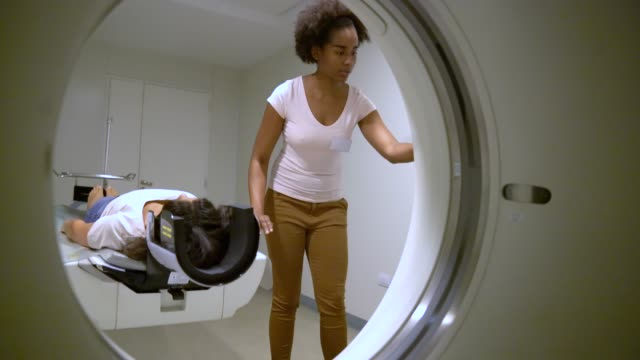 female nurse preparing patient for mri scan - low section stock videos & royalty-free footage