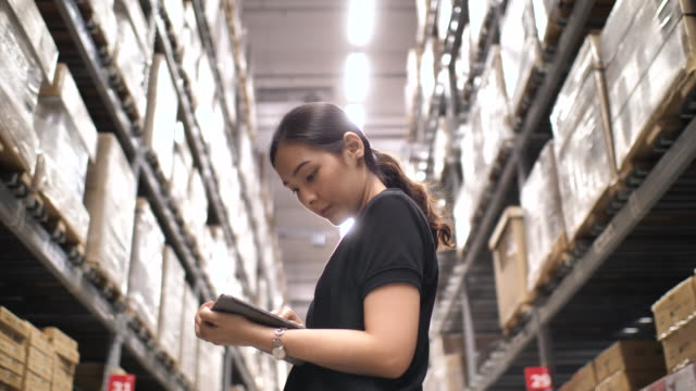 female of logistics warehouse is working on tablet pc - warehouse stock videos & royalty-free footage