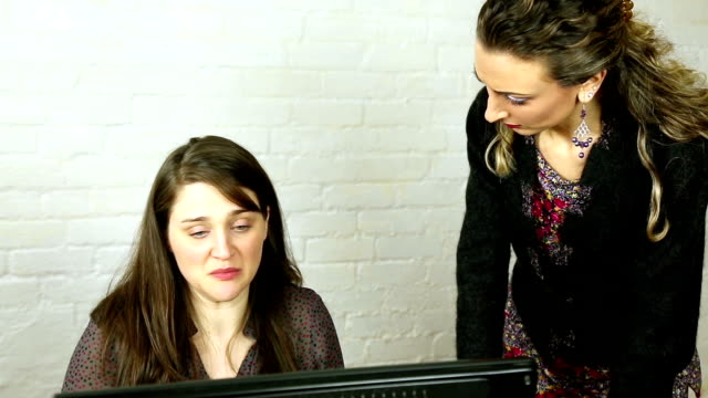 female office worker being told off about her work by supervisor - annoying colleague stock videos & royalty-free footage