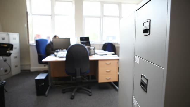 female office worker filing - filing cabinet stock videos & royalty-free footage