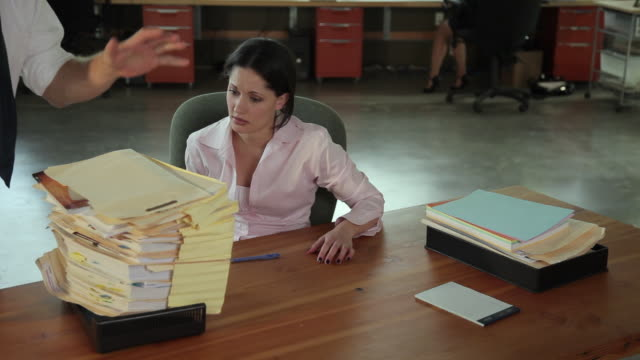 ms female office worker with stack of paperwork on desk / portland, oregon, usa - oberhemd stock-videos und b-roll-filmmaterial