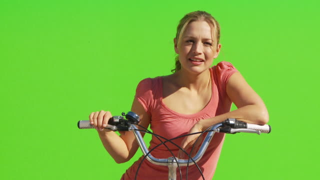 Female on bicycle smiling and facing camera