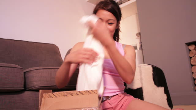 Female opening package with shopping