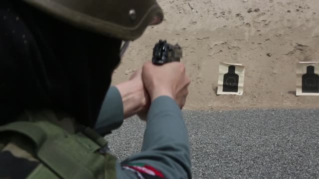 female operators assigned to the afghan general command of police special units conduct pistol marksmanship training during the first female... - afghanistan stock videos & royalty-free footage