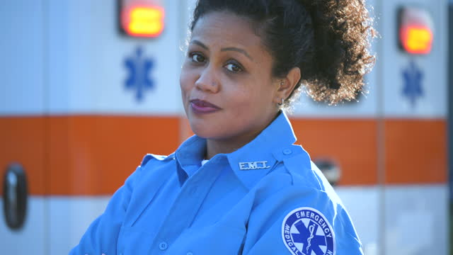 female paramedic in front of ambulance - pacific islanders stock videos & royalty-free footage
