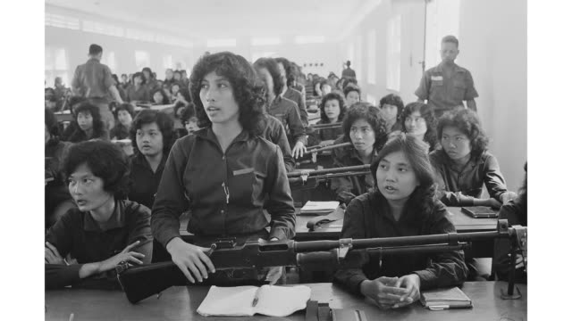 female paramilitary volunteers are given weapons training in south vietnam during the vietnam war march 1962 - vietnamkrieg stock-videos und b-roll-filmmaterial