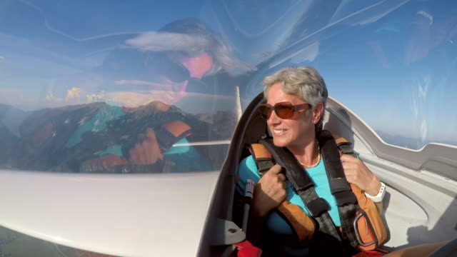 ld female passenger in a glider enjoying the view in sunshine - eyewear stock videos & royalty-free footage