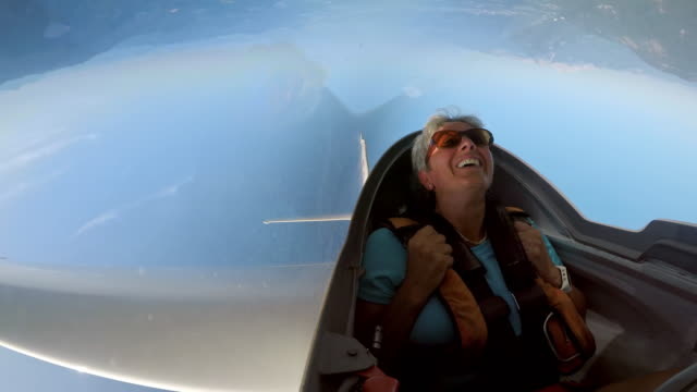 ld female passenger laughing while looping in the glider in the sunny sky - directly below stock videos & royalty-free footage