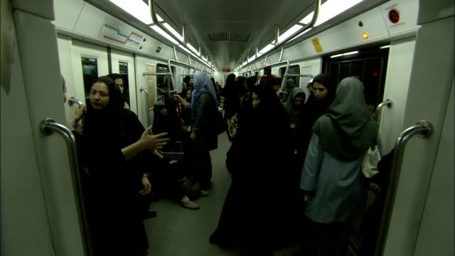female passengers ride in a subway car for women only on the tehran metro. - tehran stock videos & royalty-free footage