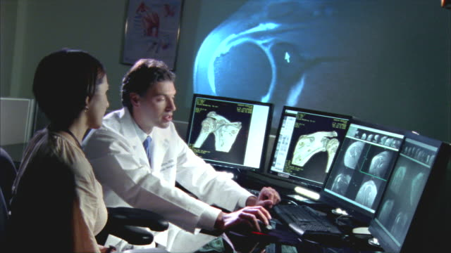 MS, Female patient and doctor showing shoulder 3D scan on computer monitor, Swedish American Heart Hospital, Rockford, Illinois, USA