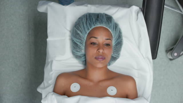 female patient being prepared for a surgery - anesthetic stock videos and b-roll footage