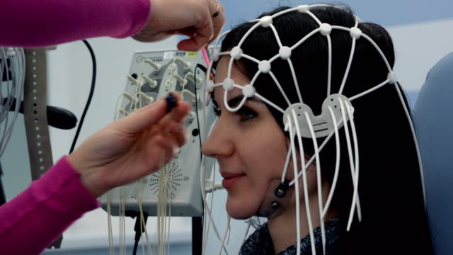 female patient getting eeg exam - scientific experiment stock videos & royalty-free footage