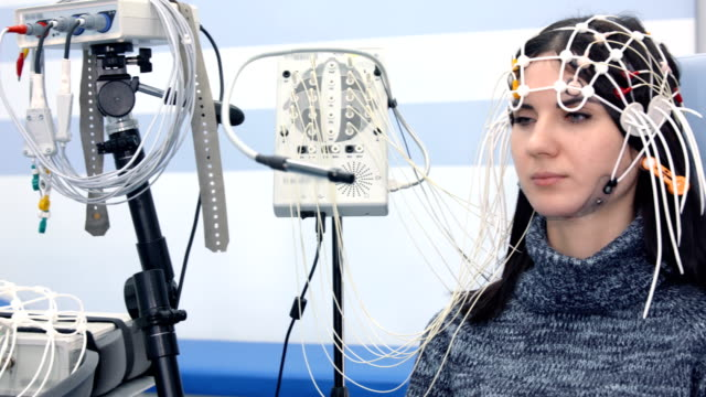 female patient getting eeg exam - salute mentale video stock e b–roll