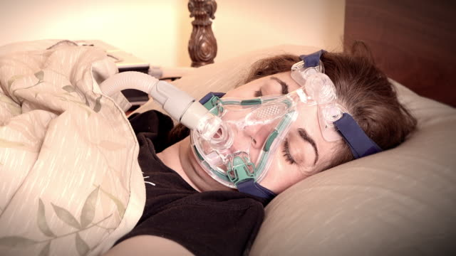 female patient suffering sleep apnea - vignettierung stock-videos und b-roll-filmmaterial