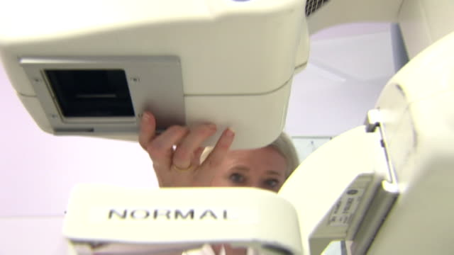 Female patient undergoing mammogram breast screening
