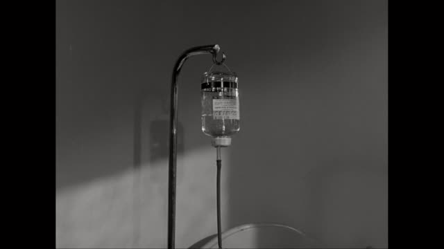 MS TD Female patient with saline intravenous iv on hospital bed / United States
