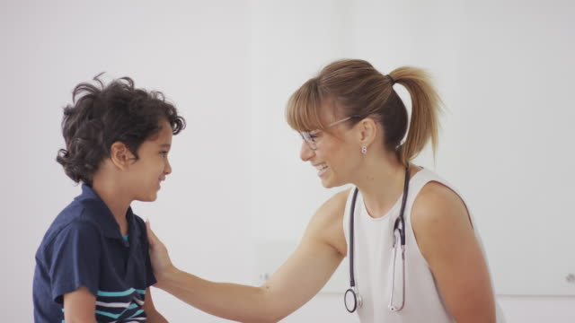 Female pediatrician with patient