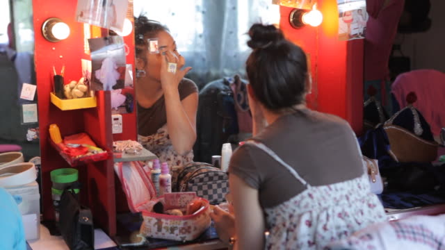 female performers applying make up - pampering self stock videos and b-roll footage