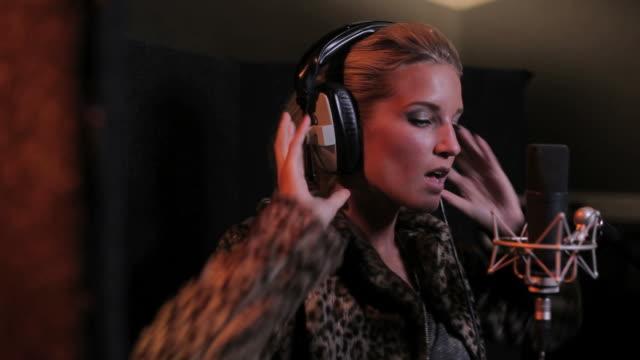 Female performing in recording studio