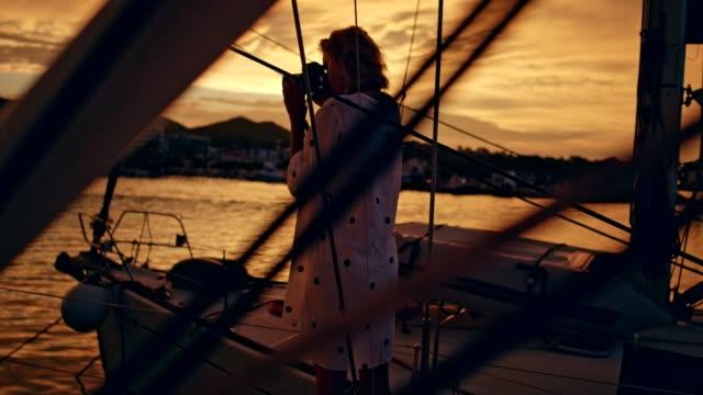 female photographer in marina. sunrise - femininity photos stock videos & royalty-free footage