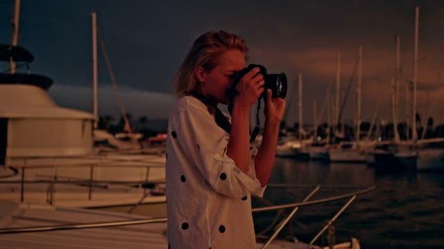female photographer in marina. sunrise - marina stock videos & royalty-free footage