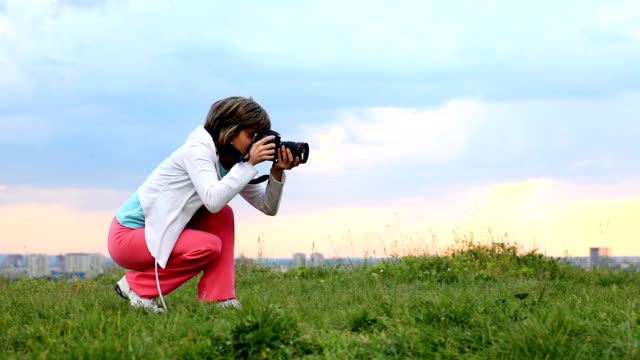 female photographer shots with digital camera. - slr camera stock videos and b-roll footage