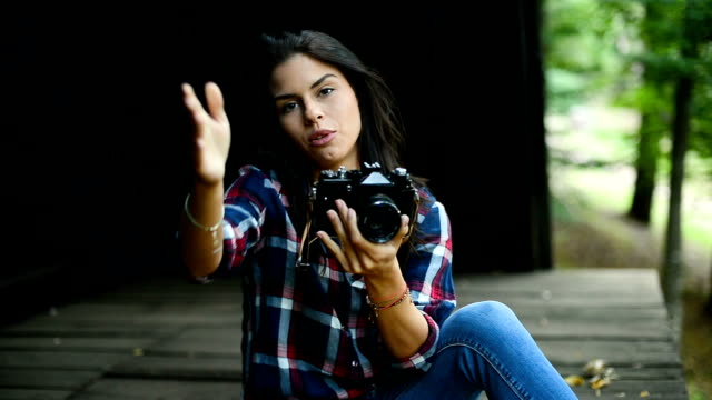 female photographer trying to get best possible shoot - photographer stock videos & royalty-free footage