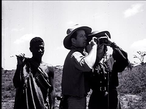 vidéos et rushes de 1947 female photographer visits the serengeti plain and views its wildlife - 1947