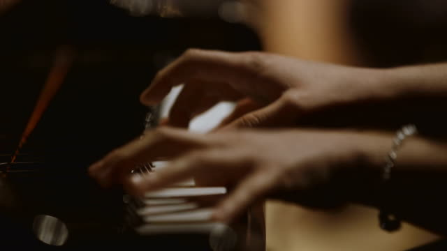 female pianist performing in concert - piano stock videos and b-roll footage