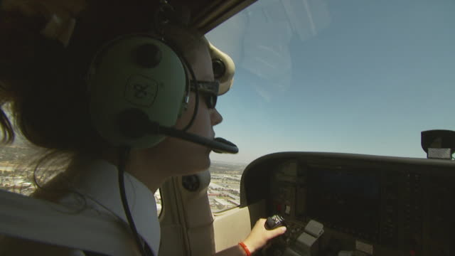 female pilot flying cessna 172, australia - piloting stock videos and b-roll footage