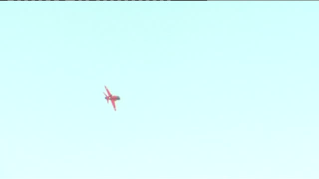 vidéos et rushes de female pilot joins the red arrows england lincolnshire raf scampton air shots of the red arrows flying overhead in formation three planes emitting... - répandre