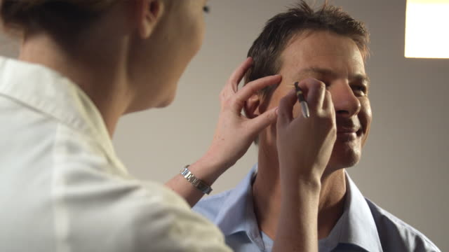 CU, Female plastic surgeon marking man's face for Botox injections, Sydney, Australia