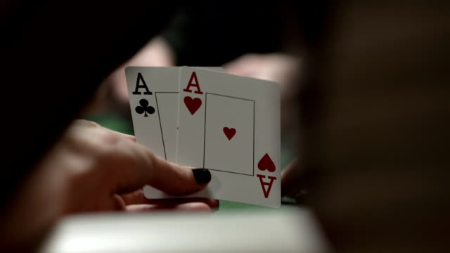 hd dolly: female player checking hole cards - hand of cards stock videos & royalty-free footage