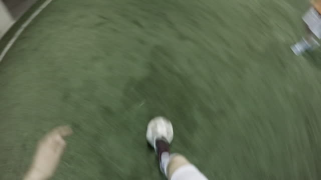 pov of female player dribbling soccer ball towards goalpost - dribbling stock videos & royalty-free footage