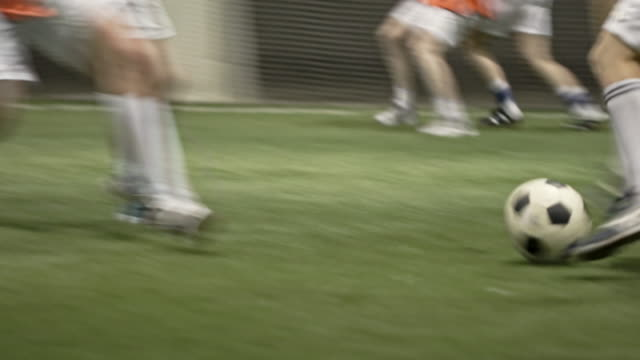 female player scoring goal during indoor soccer competition - only women stock videos & royalty-free footage