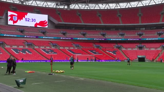 female players demanding equal pay backed by lionesses manager phil neville england london brent wembley wembley stadium ext phil neville on pitch... - paying stock videos & royalty-free footage