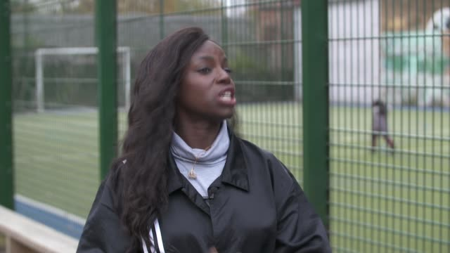 female players demanding equal pay backed by lionesses manager phil neville england london ext eni aluko interview sot wembley wembley stadium ext... - paying stock videos & royalty-free footage